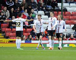 Milton Keynes Dons' Shaun Williams celebrates his goal with team mates  - Photo mandatory by-line: Joe Meredith/JMP - Tel: Mobile: 07966 386802 18/01/2014 - SPORT - FOOTBALL - Ashton Gate - Bristol - Bristol City v MK Dons - Sky Bet League One