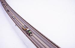 THEMENBILD - ein Traktor Fahrzeuge auf einer Brücke über den Mjosa-See, aufgenommen am 12. Maerz 2019 in Lillehammer, Norwegen // a tractor and Cars driving on a bridge over the Lake Mjosa , Lillehammer, Norway on 2018/03/12. EXPA Pictures © 2019, PhotoCredit: EXPA/ JFK