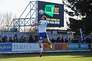AFC Wimbledon defender Luke O'Neill (2) wearing t shirt with heads up and in front og a kick it out sign heading a ball during the EFL Sky Bet League 1 match between AFC Wimbledon and Fleetwood Town at the Cherry Red Records Stadium, Kingston, England on 8 February 2020.