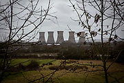 The cooling towers of Willington Coal fired power station, first commissioned in 1957 it contains four 104 M.W. generating units, Each unit, when on full load, burns approximately 1,000 tons of coal per day which produces 200 tons of ash. Willington, Derbyshire, United Kingdom.
