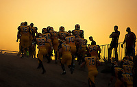The Del Oro Eagles leave the field before the game as they host the Kamehameha Warrior's at the Honor Bowl at Del Oro High School, Friday August 29, 2014. Kamehameha won the game 24-17.<br /> Brian Baer/Special to the Bee