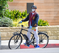 EXCLUSIVE: Robert Downey Jr rides a bike with a friend in Malibu. The pair were seen riding their bikes along PCH and a beach neighborhood. It seems at one point Robert might've had a little problem with his bike because he was seen pulling over and fiddling with the screws and chain. after a few minutes the pair were back off and headed back home. 01 Jun 2020 Pictured: Robert Downey Jr. Photo credit: Snorlax / MEGA TheMegaAgency.com +1 888 505 6342