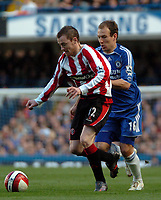 Photo: Tony Oudot.<br />Chelsea v Sheffield United. The Barclays Premiership. 17/03/2007.<br />Alan Quinn of Sheffield United is held back by Arjen Robben of Chelsea