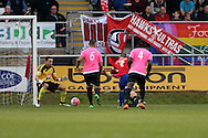 Jamie Cureton of Dagenham & Redbridge shoots and scores his sides 1st goal of the match. The Emirates FA Cup, 2nd round match, Dagenham & Redbridge v Whitehawk FC at the The London Borough of Barking & Dagenham Stadium in London on Sunday 6th December 2015.<br /> pic by John Patrick Fletcher, Andrew Orchard sports photography.