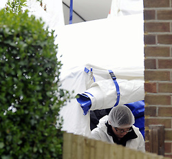 © Licensed to London News Pictures. 16/04/2012.Kent Police search a Tunbridge Wells Back garden for Human remains..Forensic teams have been scouring a back garden amid reports human remains may be lying there.Officers started searching the semi-detached property 48 Rankine Road, Tunbridge Wells from 7am today (16.04.2012)Photo credit : Grant Falvey/LNP © Licensed to London News Pictures. 16/04/2012.The garden of a house is being searched by police in Kent investigating reports that human remains may be buried there. The detailed forensic exami