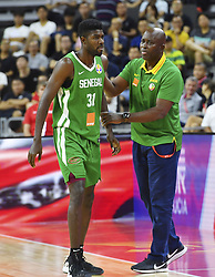 DONGGUAN, Sept. 5, 2019  Moustapha Gaye (R), head coach of Senegal consoles Babacar Toure of Senegal during the group H match between Senegal and Canada at the 2019 FIBA World Cup in Dongguan, south China's Guangdong Province, Sept. 5, 2019.  (Credit Image: RealTime Images)
