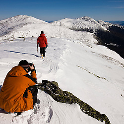 Ty Wivell photographing on Mount Clay above the Great Gulf in New Hampshire's White Mountains.  Winter. Northern Presidential mountain range.  Gulfside Trail.