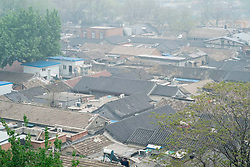 View of rooftops of old houses in area wuith many hutongs or lanes in central Beijing China