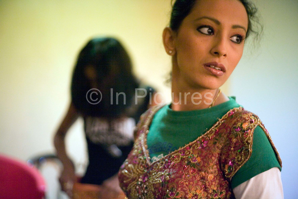 Dancer Ashwini Iyer, 23, backstage at a rehearsal of the production of The Merchants of Bollywood in a studio in Mumbai, India<br /> <br /> The Merchants of Bollywood, An Indian theatrical dance musical, charts the history of the world's largest and most prolific film industry, and is loosely based on the showbusiness, Merchant family. Seen by over two million people worldwide, the show is homage to the world of Indian cinema.