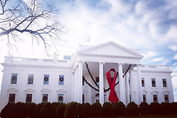 December 1, 2017 - Washington, DC, United States of America - A giant red ribbon on the West Portico of the White House marking World AIDS Day December 1, 2017 in Washington, DC. (Credit Image: © White House/Planet Pix via ZUMA Wire)
