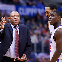 01 February 2014: Los Angeles Clippers head coach Doc Rivers talks to Los Angeles Clippers point guard Darren Collison (2) and Los Angeles Clippers center Ryan Hollins (15) during the Los Angeles Clippers 102-87 victory over the Utah Jazz at the Staples Center, Los Angeles, California, USA.