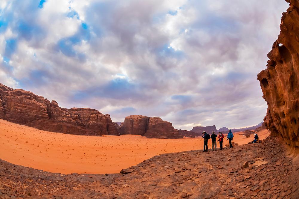 Travelers enjoy a panoramic view of the Arabian Desert at Wadi Rum, Jordan.