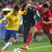 Turkey's Ismail Koybasi (R) and Brazil's Neymar JR (L) during their a international friendly soccer match Turkey betwen Brazil at Sukru Saracoglu Arena in istanbul November 12, 2014. Photo by Aykut AKICI/TURKPIX