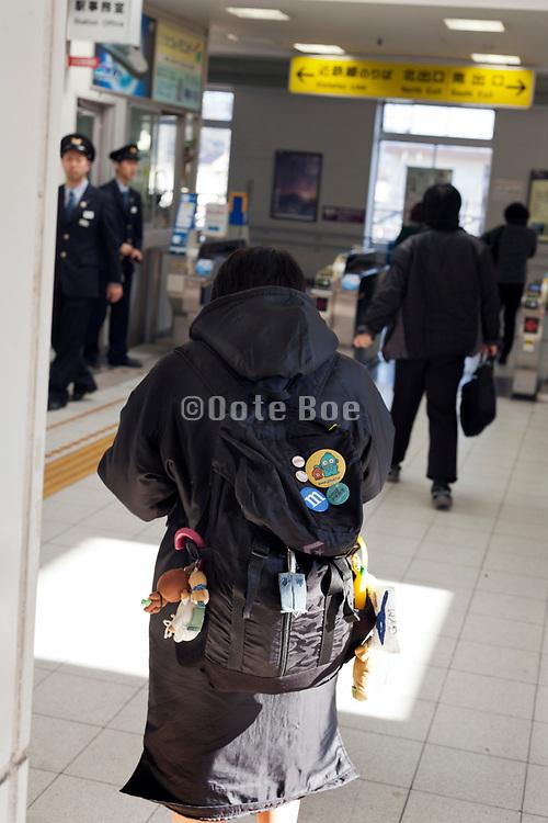 people exiting a rural train station stop near Nara Japan
