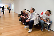 tourist taking a break while visiting the Museum of Modern Art