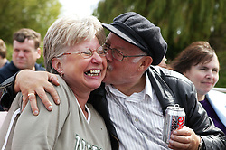 An affectionate moment between elderly friends on an outing to York,