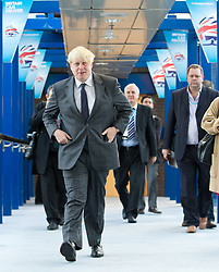 © Licensed to London News Pictures. 09/10/2012. Birmingham , UK . Boris Johnson enters the conference centre in advance of his speech , surrounded by news media . Day 3 of the Conservative Party Conference at the International Convention Centre in Birmingham . Photo credit : Joel Goodman/LNP