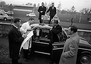 17/3/1966<br /> 3/17/1966<br /> 17 March 1966<br /> <br /> Mr. Peter Roche(2nd frm. right) of Balgriffin watching Jerry O'Meara and Patrick Simpson of Smith Service and Sales Department checking Mr. Roche's petrol consumption in his Renault 4l Economy Run. Mr. Roche was the joint winner of the competition with a return of 59 Miles per gallon