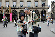 Japanese couple looking at there map near the Louvre in Paris