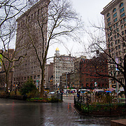 Flatiron building under the rain from the Madison Square park, Manhattan, New York City