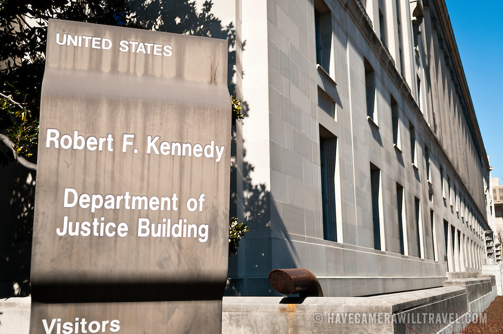 Sign of the Robert F. Kennedy Department of Justice Building at 950 Pennsylvania Ave NW in downtown Washington DC. It is the main national headquarters of the DoJ.