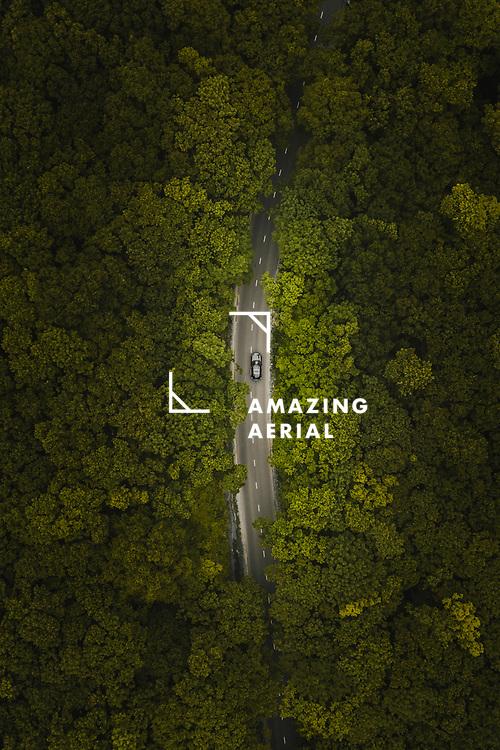 Aerial view of hidden road in green forest of Russky Island, Vladivostok, Russia.