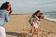 Three young women taking a picture on the beach.