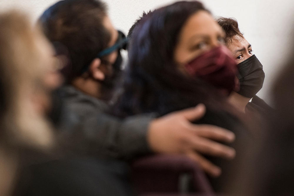 Stephanie Ybarra (right) becomes emotional at her mother Carmelita Martinez' funeral at Pastor El Buen church in San Jose, Calif. on Feb. 3, 2021.