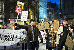 © Licensed to London News Pictures . 20/02/2017 . Manchester , UK . Hundreds of protesters march to a Stop Trump demonstration in Albert Square , central Manchester , to coincide with Parliament debating a petition calling for the government to cancel a State Visit by US President Donald Trump . Photo credit: Joel Goodman/LNP