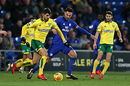 Sean Morrison of Cardiff city ©  challenges Nelson Oliveira of Norwich city (l). EFL Skybet championship match, Cardiff city v Norwich city at the Cardiff city stadium in Cardiff, South Wales on Friday 1st December 2017.<br /> pic by Andrew Orchard, Andrew Orchard sports photography.