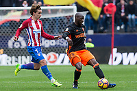 Antoine Griezmann of Atletico de Madrid competes for the ball with Eliaquim Mangala of Valencia CF  during the match of Spanish La Liga between Atletico de Madrid and Valencia CF at  Vicente Calderon Stadium in Madrid, Spain. March 05, 2017. (ALTERPHOTOS / Rodrigo Jimenez)