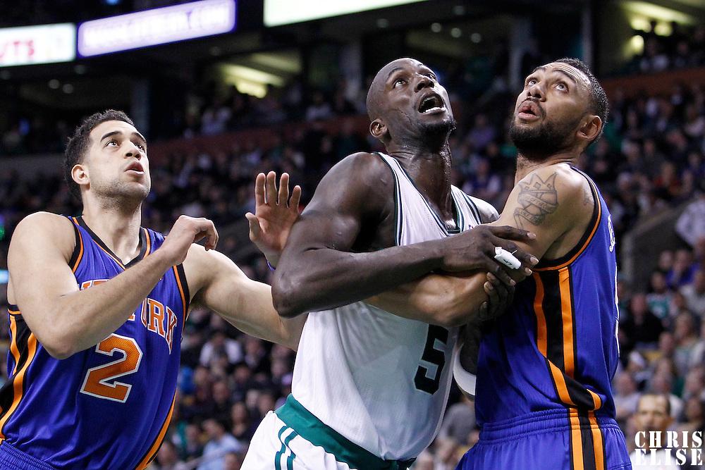 04 March 2012: Boston Celtics power forward Kevin Garnett (5) vies for the rebound with New York Knicks power forward Jared Jeffries (9) during the Boston Celtics 115-111 (OT) victory over the New York Knicks at the TD Garden, Boston, Massachusetts, USA.