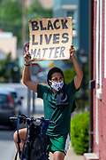 A demonstrator holds a Black Lives Matter sign  at 4th and Chestnut Streets during the Mifflinburg Pride Event.