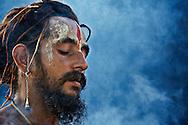 A Naga Sadhu performing the regular rituals during the Solar Eclipse Fair in Kurukshetra, Haryana, India.