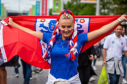 © Licensed to London News Pictures. 07/07/2021. LONDON, UK.  An England fan with facepaint and decorated hair arrives outside Wembley Stadium ahead of the Euro 2020 semi-final between England and Denmark.  60,000 supporters, the most to watch a game since the pandemic began, will be in the stands as the UK government eased restrictions.  Photo credit: Stephen Chung/LNP