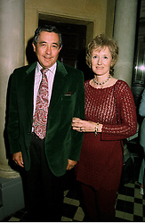 COUNT & COUNTESS PIERRE DE CABARRUS she is the sister of the Duke of Northumberland, at a party in London on 9th June 1997.<br /> LZC 34A