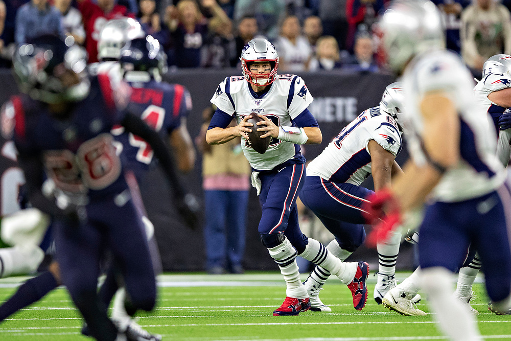 HOUSTON, TX - DECEMBER 1:  Tom Brady #12 of the New England Patriots runs the ball in the first half of a game against the Houston Texans at NRG Stadium on December 1, 2019 in Houston, Texas.  The Texans defeated the Patriots 28-22.  (Photo by Wesley Hitt/Getty Images) *** Local Caption *** Tom Brady