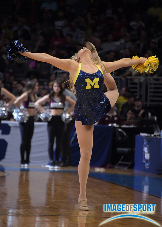 Michigan Wolverines cheerleader during a West Regional semifinal of the NCAA men's college basketball tournament against the Texas A&M Aggies, Thursday, March 22, 2018, in Los Angeles.