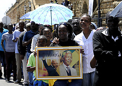 PRETORIA, Dec. 13, 2013  People wait in line for viewing the body of late former South African President Nelson Mandela in Pretoria, Dec. 13, 2013. The three-day body viewing of late former South African President Nelson Mandela ended in Pretoria on Friday with over 100,000 people estimated to have paid homage to the anti-apartheid icon. (Xinhua/Li Qihua) (Credit Image: © Li Qihua/Xinhua/ZUMAPRESS.com)