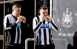 Newcastle United fans eat food before the Premier League match at St James' Park, Newcastle.