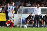 AFC Wimbledon manager Neal Ardley shouting during the EFL Sky Bet League 1 match between AFC Wimbledon and Portsmouth at the Cherry Red Records Stadium, Kingston, England on 13 October 2018.