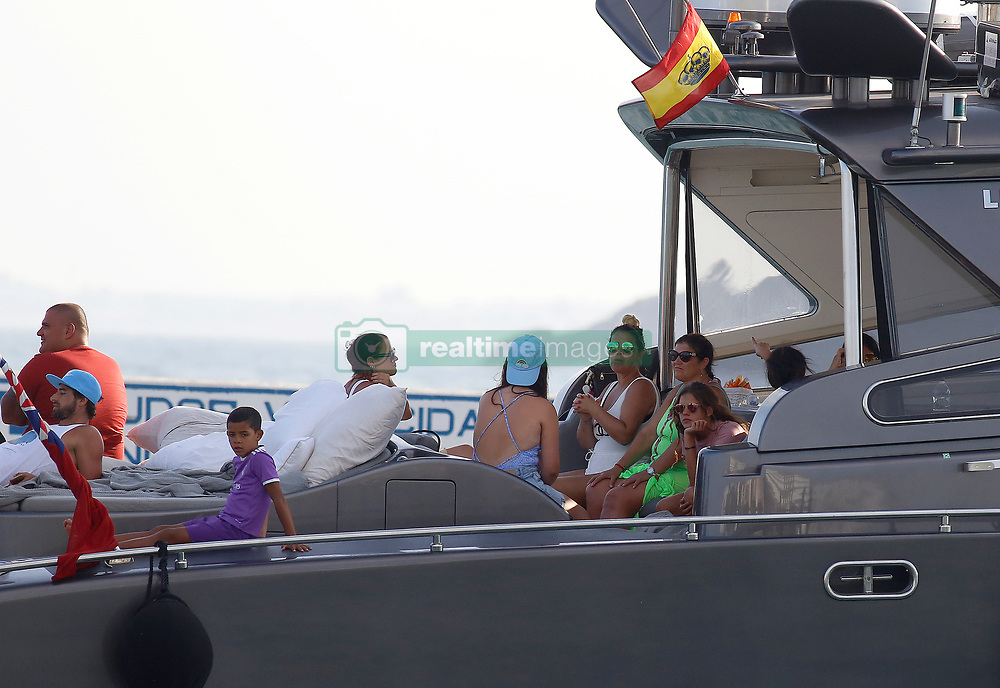 EXCLUSIVE: The Real Madrid Footballer, Cristiano Ronaldo, is seen leaving with a gesture of concern and guarded by his security team minutes after being approached by Police of the Customs Tax Agency. Three armed agents inspected the yacht of the footballer while it rested in its interior With his girlfriend, Georgina, his mother, Dolores, and a group of relatives and friends on July 8, 2017 in Ibiza, Spain. 08 Jul 2017 Pictured: Maria Dolores dos Santos Aveiro and Georgina Rodriguez. Photo credit: Elkin Cabarcas / MEGA TheMegaAgency.com +1 888 505 6342