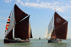 © Licensed to London News Pictures. 22/08/2015.  The traditional Thames Sailing Barge Match has taken place on the river in beautiful late summer sunshine. The annual race between the Thames sailing barges first took place in 1863. Today's race took place under blue skies and high temperatures. The race started from Mucking, Essex, with the finish at Gravesend, Kent. The barges have iconic red sails. Credit : Rob Powell/LNP