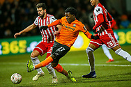 Barnet midfielder Ephron Mason-Clark (27) beats Brentford defender Yoann Barbet (29) to shoots towards the goal during the The FA Cup fourth round match between Barnet and Brentford at The Hive Stadium, London, England on 28 January 2019.