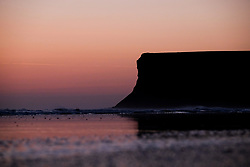 © Licensed to London News Pictures. <br /> 06/04/2017<br /> Saltburn-by-the-Sea, UK. <br />  <br /> The sun rises behind Huntcliff at Saltburn-by-the-Sea in North Yorkshire. <br /> <br /> Photo credit: Ian Forsyth/LNP