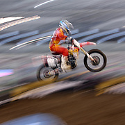 A blur of motion asMatthew Bisceglia, Honda, competes during the Monster Energy AMA Supercross series held at MetLife Stadium. 62,217 fans attended the event held for the first time at MetLife Stadium, New Jersey, USA. 26th April 2014. Photo Tim Clayton