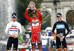 11.09.2011, Madrid,  ESP, LA VUELTA 2011, Finish, im Bild Juan Jose Cobo (c) celebrates the victory in La Vuelta 2011 in presence of Bradley Wiggins, Second place (l) and Christophe Froome,third place (r).September 11,2011. EXPA Pictures © 2011, PhotoCredit: EXPA/ Alterphoto/ Paola Otero +++++ ATTENTION - OUT OF SPAIN/(ESP) +++++