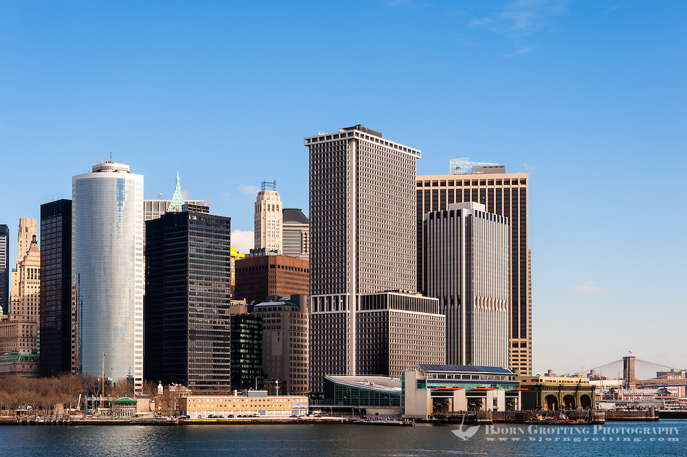 US, New York City. Lower Manhattan seen from the Staten Island ferry. Ferry terminal and Battery Park.