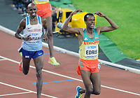 Athletics - 2017 IAAF London World Athletics Championship - Day Thirteen, Evening Session<br /> <br /> Men's 5000m Final<br /> <br />  Muktar Edris of Ethiopia does the 'Mo Bot' as he crosses the line for the Gold medal ahead of Mo Farah of Great Britain at the London Stadium.<br /> <br /> COLORSPORT/ANDREW COWIE