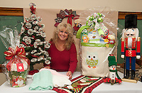 Di Greenwood goes through items including spectacular Theme Baskets Raffle items that will be available during the annual Nutcracker Christmas Fair at Sainte Andre Bassette Parish November 7th and 8th.  (Karen Bobotas/for the Laconia Daily Sun)